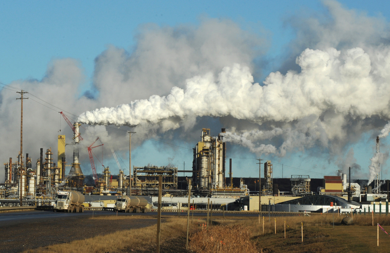 View of the Syncrude oil sands extraction facility near the town of Fort McMurray in Alberta Province, Canada on October 25, 2009.  Greenpeace is calling for an end to oil sands mining in the region due to their greenhouse gas emissions and have recently staged sit-ins which briefly halted production at several mines. At an estimated 175 billion barrels, Alberta's oil sands are the second largest oil reserve in the world behind Saudi Arabia, but they were neglected for years, except by local companies, because of high extraction costs. Since 2000, skyrocketing crude oil prices and improved extraction methods have made exploitation more economical, and have lured several multinational oil companies to mine the sands.            AFP PHOTO/Mark RALSTON (Photo credit should read MARK RALSTON/AFP/Getty Images)