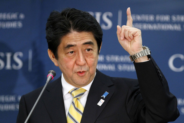 Japanese Prime Minister Shinzo Abe gestures as he speaks about Japan, Friday, Feb. 22, 2013,  at the Center for Strategic International Studies in Washington. (AP Photo/Jacquelyn Martin)