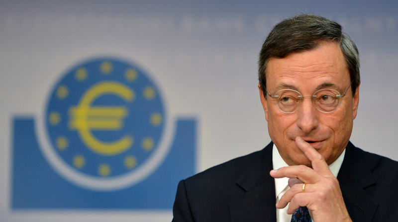 Mario Draghi, President of the European Central Bank (ECB), addresses the media following a meeting with the ECB's council in Frankfurt am Main, western Germany, on September 6, 2012. The European Central Bank unveiled a fresh programme to buy bonds issued by heavily indebted eurozone countries, under strict conditions, in a widely-anticipated bid to save the euro. Echoing remarks issued by German and Spanish leaders almost simultaneously in Madrid, ECB president Mario Draghi said the central bank would buy unlimited volumes of bonds with maturity of up to three years.     AFP PHOTO / JOHANNES EISELE