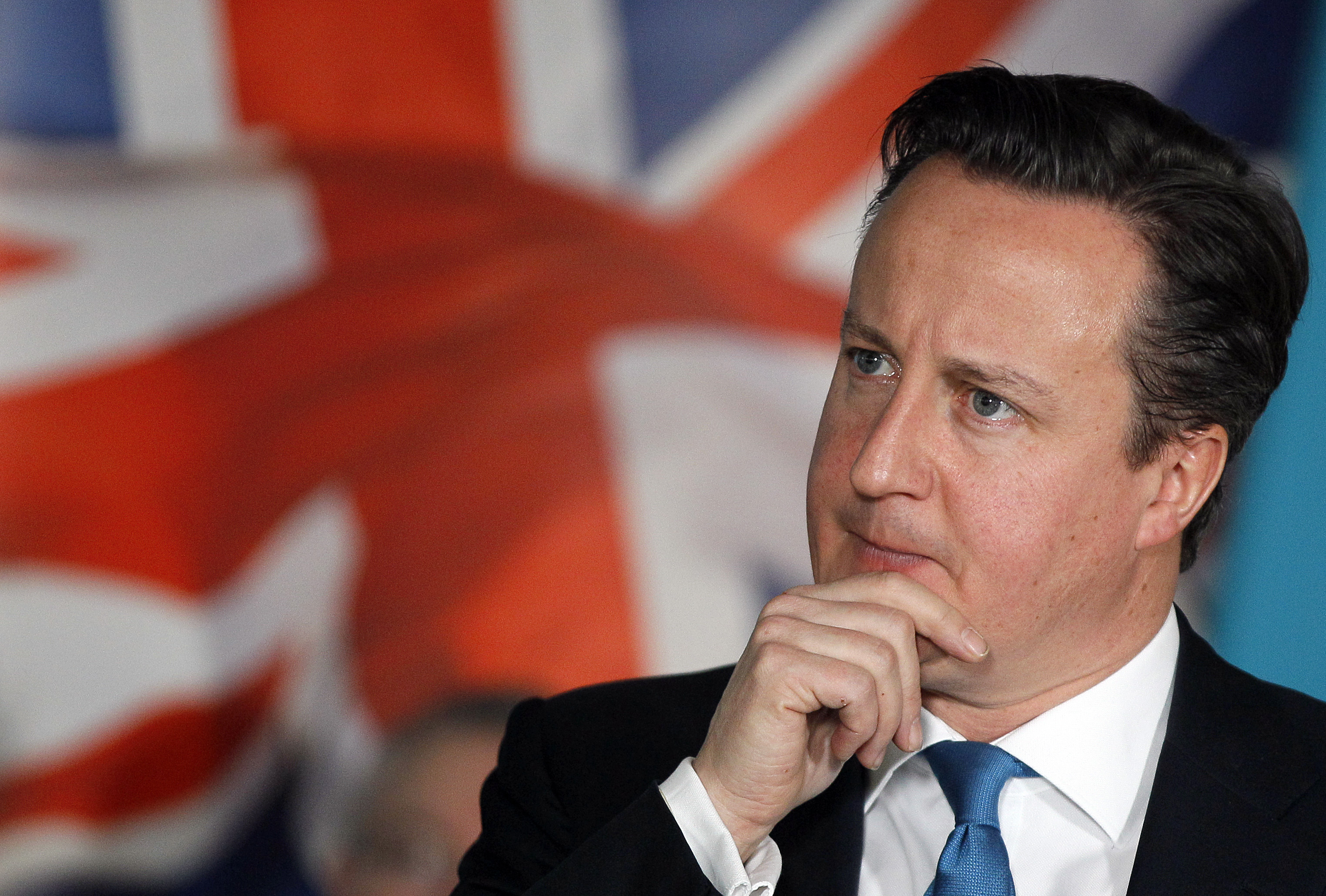 Britain's Prime Minister David Cameron listens to a question during a Prime Minister Direct session during a visit to accountancy software company Intuit, in Maidenhead, England, Thursday, Jan. 5, 2012. (AP Photo/Kirsty Wigglesworth, pool)